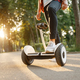 Young male person riding on gyroboard in park - PhotoDune Item for Sale