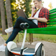 Man with gyroboard sitting on the bench in park - PhotoDune Item for Sale