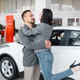 Couple buying new car, man and woman hugging - PhotoDune Item for Sale