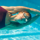 young woman diving in swimming pool, underwater shot - PhotoDune Item for Sale