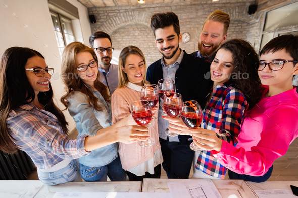 Group of successful architects celebrating in office - Stock Photo - Images