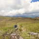 Panorama of boy backpacking in mountains. - PhotoDune Item for Sale