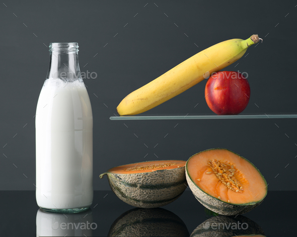 bottle of milk and fruits on gray background - Stock Photo - Images