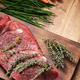 Rosemary on delicious stake next to fresh vegetables on rustic wooden table - PhotoDune Item for Sale