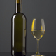 Spanish wine bottle and full glass on black glass - PhotoDune Item for Sale