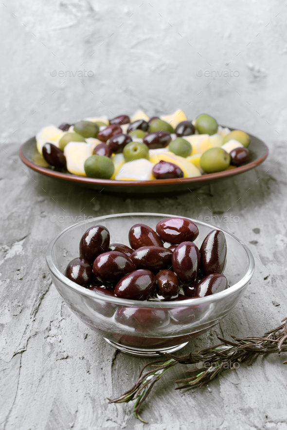 glass bowls with green and black olives, on gray rustic stage - Stock Photo - Images