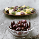 glass bowls with green and black olives, on gray rustic stage - PhotoDune Item for Sale