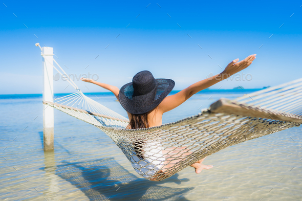 Portrait beautiful young asian woman sitting on hammock around s - Stock Photo - Images