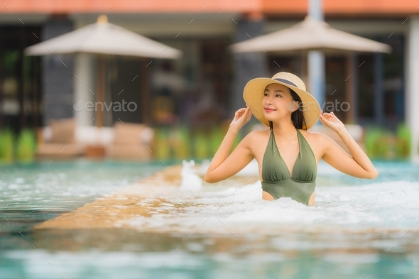 Portrait beautiful young asian woman relax in luxury outdoor swi - Stock Photo - Images