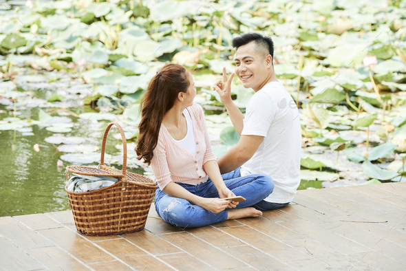 Couple resting on the pier - Stock Photo - Images