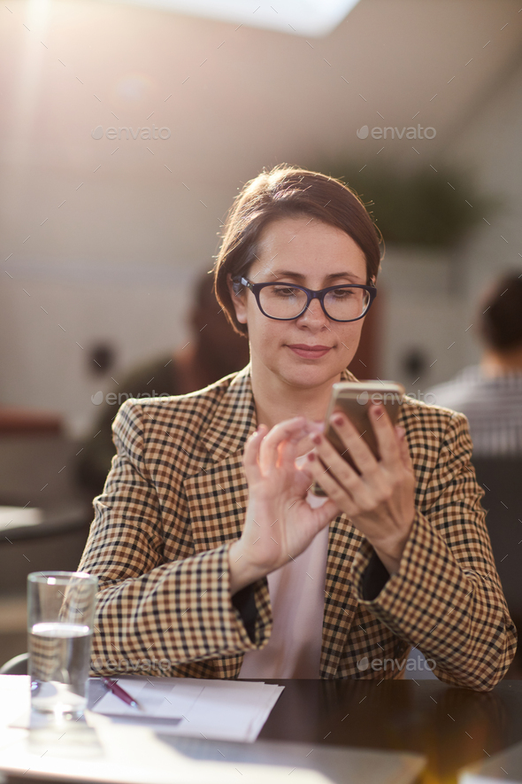 Business Woman Using Smartphone in Cafe - Stock Photo - Images