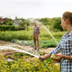 Young and happy farmer's couple at their garden in sunny day - PhotoDune Item for Sale