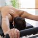 Man exercising on pilates reformer bed - PhotoDune Item for Sale