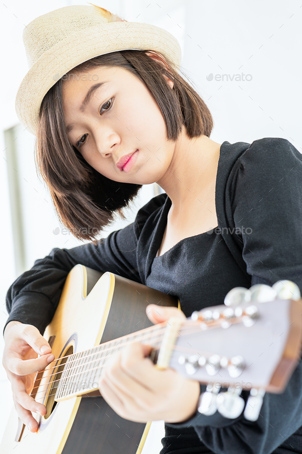Close up woman playing guitar_ - Stock Photo - Images