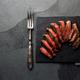 Medium rare beef steak on slate board, vintage cutlery, grey background - PhotoDune Item for Sale