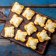 Mini empanadas on wooden board, blue background. Top view. - PhotoDune Item for Sale