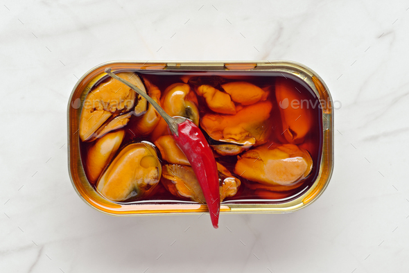 can of mussels with red chili - Stock Photo - Images