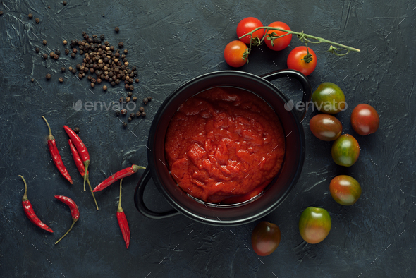 tomato sauce and chili peppers on textured background - Stock Photo - Images