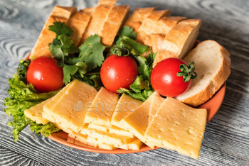 Swiss cheese with bread and vegetables