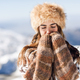 Young woman enjoying the snowy mountains in winter - PhotoDune Item for Sale