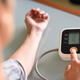 Woman measuring her own blood pressure at home - PhotoDune Item for Sale