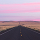 Dawn Breaks over Long Two Lane Road Blacktop Highway - PhotoDune Item for Sale