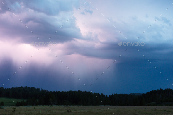 A storm passes thru quickly over Norris Canyon Road in Yellowstone - Stock Photo - Images