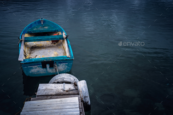 Small blue wooden rowing fisherman boat - Stock Photo - Images