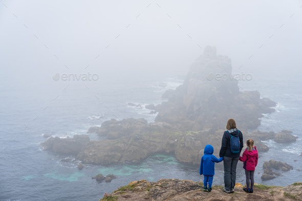 Family admiring landscape of the Lands End - Stock Photo - Images