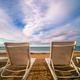 Empty white plastic sunbeds on Tsilivi Beach - PhotoDune Item for Sale