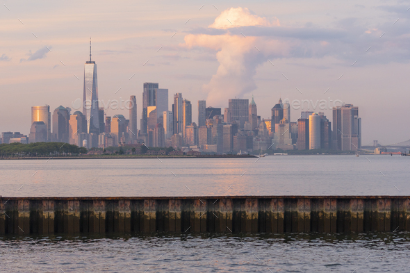 Dramatic Light Reflects off the Buildings and Infrastructure of Manhattan NY - Stock Photo - Images
