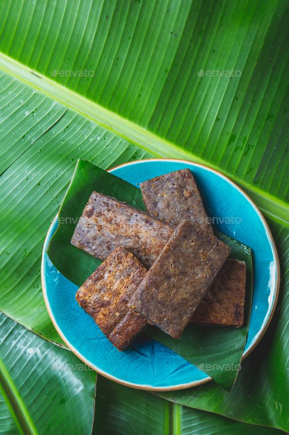 Easter Island Tahitian Polynesian banana pie pupping POE on blue plate on banana palm tree leaves. - Stock Photo - Images
