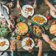 Friends feasting at Thanksgiving Day table with turkey, top view - PhotoDune Item for Sale