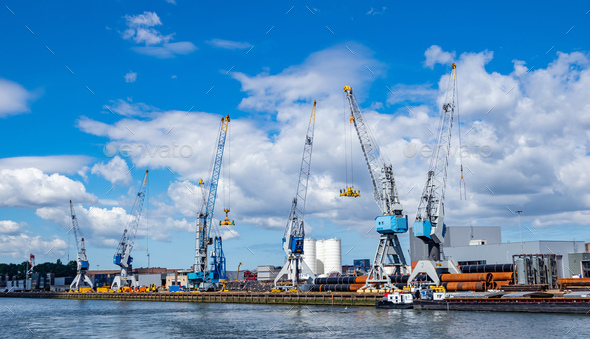 Cranes at port of Rotterdam, Netherlands. Logistics business, cargo loading unloading - Stock Photo - Images