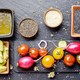 Top view at fresh organic vegetables on slate stone tray with sp - PhotoDune Item for Sale