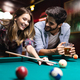 Couple drinking beer and playing snooker on date - PhotoDune Item for Sale