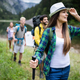 Group of happy young people friends hiking together outdoor - PhotoDune Item for Sale