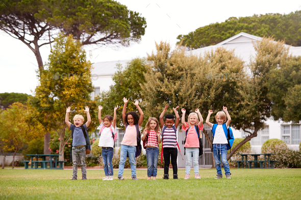 Excited Elementary School Pupils On Playing Field At Break Time - Stock Photo - Images