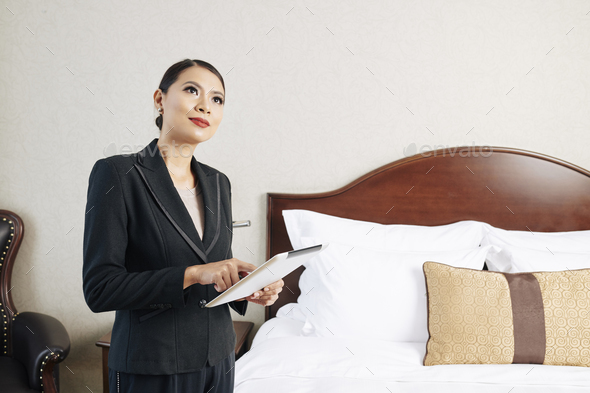 Manager of the hotel using tablet pc - Stock Photo - Images