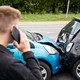 Young Male Motorist Involved In Car Accident Calling Insurance Company Or Recovery Service - PhotoDune Item for Sale