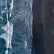 Aerial drone view of ocean waves washing black basaltic sand beach, Iceland - PhotoDune Item for Sale