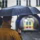 Man with umbrella looking at leaving ambulance car - PhotoDune Item for Sale