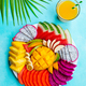 Tropical Fruits Assortment on a White Plate with Mango Smoothie, Juice. Blue Background. Top view. - PhotoDune Item for Sale