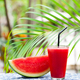 Watermelon Fresh Juice, Smoothie on Tropical Outdoor Background with Palm Leaves. Copy space. - PhotoDune Item for Sale