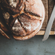 Freshly baked sourdough bread loaf and slices, copy space - PhotoDune Item for Sale