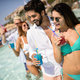 Summer party. Friends at beach drinking coctails and having fun - PhotoDune Item for Sale