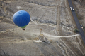 Blur hot air balloon flying over the road with motor transport. View from above - PhotoDune Item for Sale