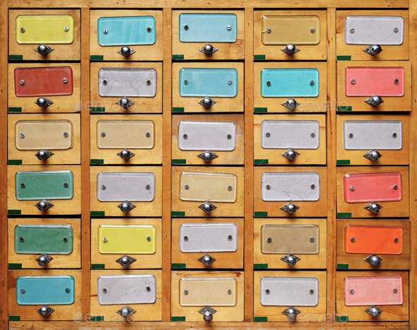 Vintage wooden cabinet with multicolor labels - Stock Photo - Images