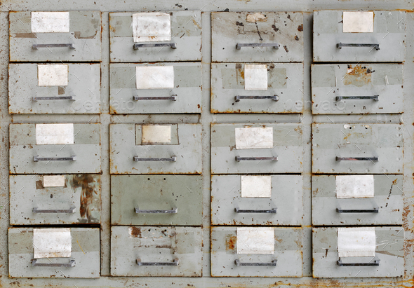 Vintage grey metal cabinet with drawers - Stock Photo - Images