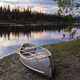 Sunset sky and canoe at Teslin River Yukon Canada - PhotoDune Item for Sale